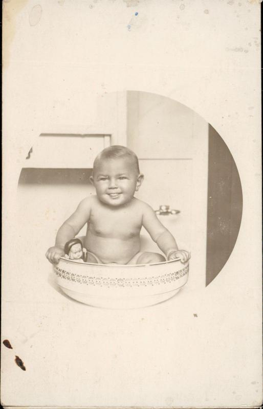 smiling baby cute having a bath real photo vintage