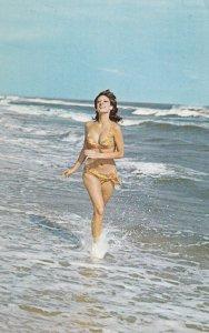 PIN-UP; Girl in bikini running , 1950-60s