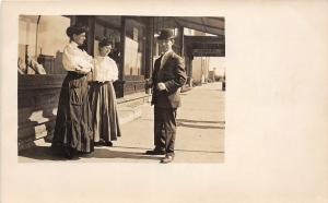 F36/ Newcastle Wyoming Postcard RPPC c1910 Store Man Top Hat Women