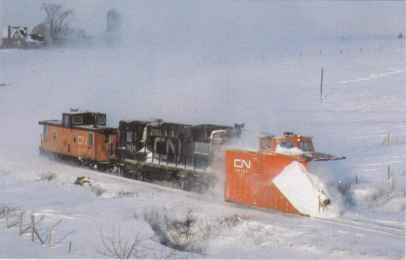 MILFORD , Nova Scotia , 1987 ; Railroad Train snowplow at work