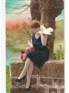 CLady in blue. Playing qwith doves  Nice old vintage French postcard