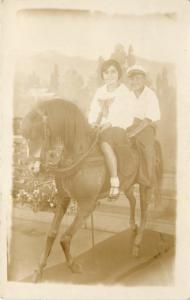 Young Couple On A Big Wooden Horse~Real Photo Postcard c1934