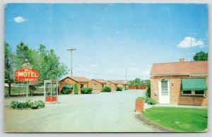 Pueblo Colorado~Bell Motel~Telephone Booth by Neon Art Deco Sign~1959 Postcard