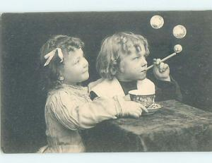Pre-1907 foreign GIRL WATCHES BOY BLOWING SOAP BUBBLES WITH STRAW HL7274