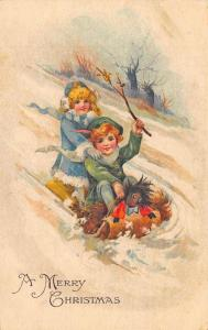 Merry Christmas Young Boy & Girl Tobogan Black Doll Postcard