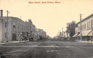 Sauk Centre MN Dirt Main St~Bldg Faces Corner~Long One w/Cornices c1910 Postcard