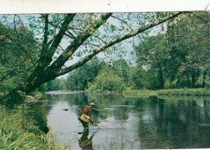 P1730 1958 angler bass fishing penn river netting a fish
