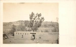 c1910 RPPC Postcard; Man Standing outside Adobe House, Unknown Arizona Location
