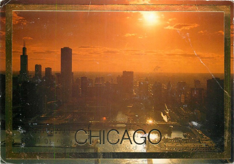 USA sunset over chicago at the left the sears tower Postcard