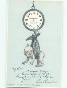 Pre-Linen BABY HANGING FROM WEIGH SCALE AC1794