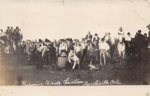 Bartlesville Oklahoma~Preparing to Ride Steer~Rodeo~Men on Cow~Cowboys~1909 RPPC
