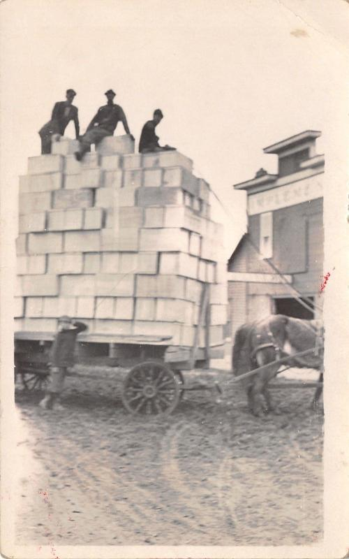 Hartwick Iowa~Huge Delivery to Implement Company~Men on Top Wagonload~c1910 RPPC