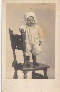 1904-1918 RPPC AZO Studio View Portrait Baby Standing On Chair