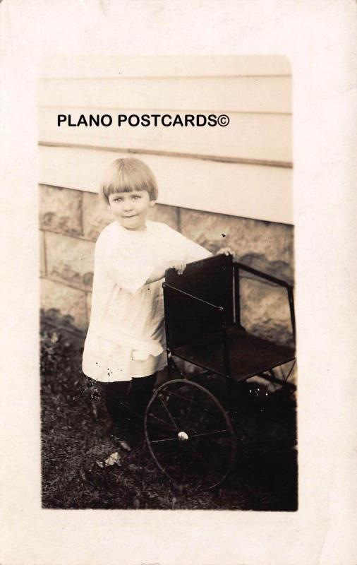 EARLY 1900'S GIRL WITH SMALL ROLLING CHAIR RPPC REAL PHOTO POSTCARD