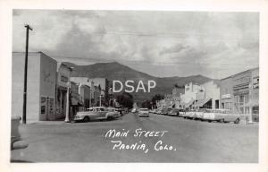 Colorado CO Postcard Real Photo RPPC c1950s PAONIA Main Street Stores Cars CAFE