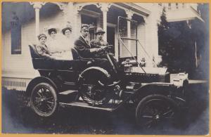 RPPC - Family going for ride in 1909 Ford Model T or Maxwell Auto