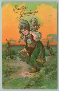 PFB Easter~Dutch Girl Carries Lamb Around Her Neck~Wooden Shoes~Embossed~1911