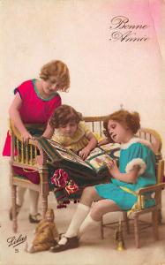 Hand Tinted French Children Browsing Postcard Album RPPC