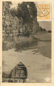 Latvia Postcard the picturesque shores of the Daugava near Plavinam boat