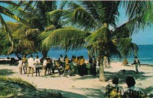 Antigua Beach Scene Dancing To Calypso Rythm Of Steel Drums