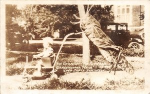 F56/ Columbus Nebraska RPPC Postcard 1938 Grasshopper Exaggeration