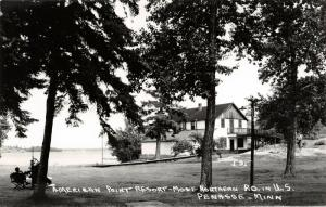 Penasse Minnesota~American Point Resort Hotel Inn~Men Relax on Lawn~1950s RPPC