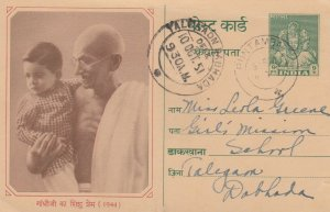 GHANDI , India , 1944 ; Holding a child