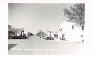 Tioga ND Heinle Rexall~Montana-Dakota~Simpson Plumbing~RPPC 1959 Ford Fairlane