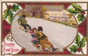 NEW YEAR; Children sliding down snowy hill on a sled, Holly, Gold detail, 00-10s