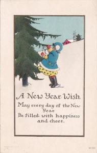 A New Year Wish Young Girl Decorating Tree 1915
