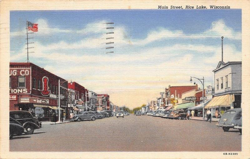 Rice Lake Wisconsin~Main Street~Drug Store~Saks~1940s Cars~1952 Linen Postcard