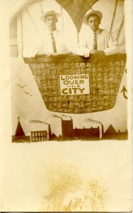 Looking Over the City. Two Men, Studio Photo     *RPPC
