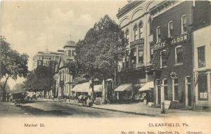 c1906 Lithograph Postcard  Market Street Scene Clearfield PA Hotel Bloom posted