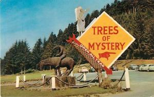 Sign, Carving at Entrance to Trees of Mystery California CA