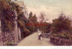 DEVON, ENGLAND. LYNTON, NORTH WALK Frith Series man and woman pause