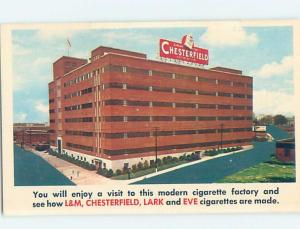 Pre-1980 CHESTERFIELD BILLBOARD SIGN AT CIGARETTE FACTORY Durham NC c6950