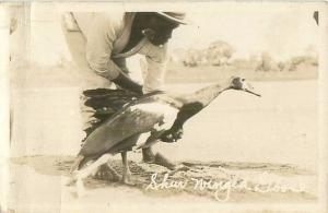 Spur Winged Goose and African Man in Africa RPPC Postcard 1907-1929