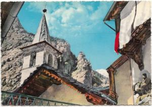 Italy, house, Church in village & mountain in background, unknown location