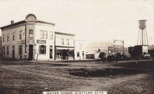 RP: STETTLER , Alberta , Canada , 1900-10s ; Street view w/ Water tower