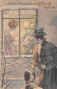 BG14637 man with dog woman making christmas tree weihnachten m vienne germany