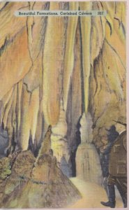 Carlsbad Caverns NM - Tom Boles poses with  stalagmites  1930/40s