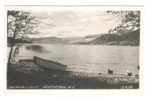 RP; Rowboats tied to the shore, Lake Skaha, Penticton, British Columbia, Cana...