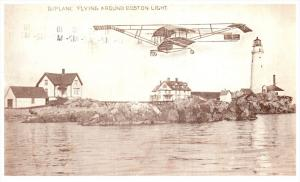 19210 Biplane Flying around Boston Light  1910
