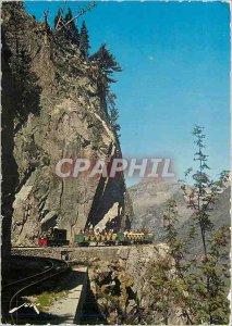 Postcard Modern Artouste Lake Train winds its ledge in the wall