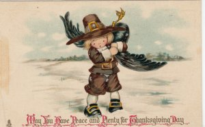 THANKSGIVING; PU-1911; Boy carrying a turkey over his shoulder, TUCK No. 801