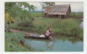 P2146,  soldiers postcard viet nam to millersburg ohio rural girl in boat scene