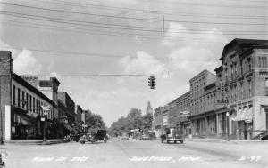 Jonesville MI~Main Street East~Gilmer Hotel~Goodyear~Standard Gas~1930 Cars~RPPC