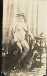 RP: Woman wearing only a hat in chair , Guitar, 00-10s