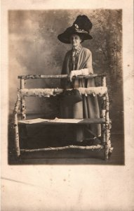 VINTAGE POSTCARD WOMAN WITH EXTRAVAGANT HAT AND PURSE REAL PHOTO CARD