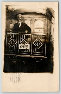 Leaving Denver Colorado~Ed Clareen~Man on Train Caboose~1910 Studio RPPC